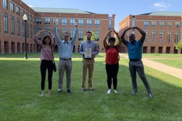 Team of Fisher Students posing with arms in O-H-I-O