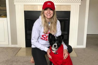 Alyssa and her dog in OSU gear