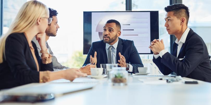 People speaking in a boardroom