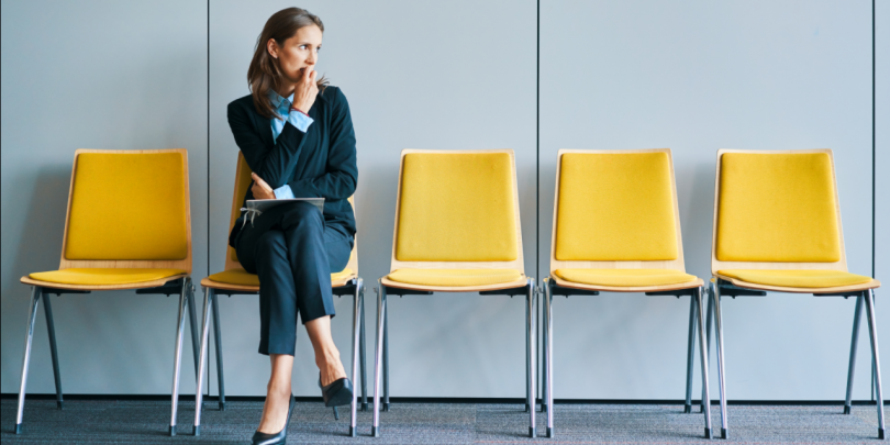 Woman sitting in chair waiting for a job interview