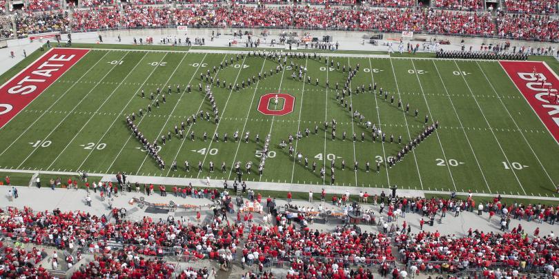 Ohio State Marching Band at Ohio Stadium Making Recycle Emblem