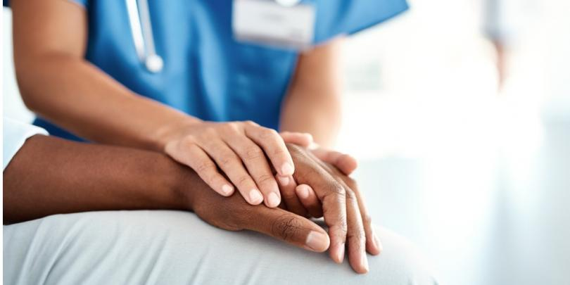 Female nurse helping someone