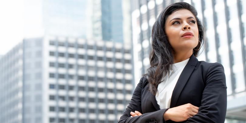 Latina women in business suit crossing arms