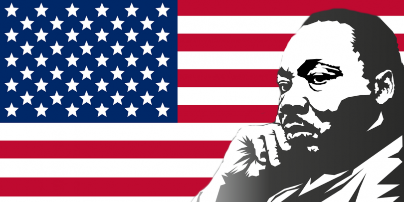 Martin Luther King, Jr. in front of American flag