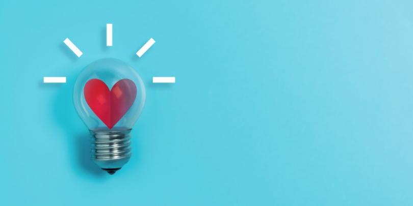 glowing heart inside lightbulb