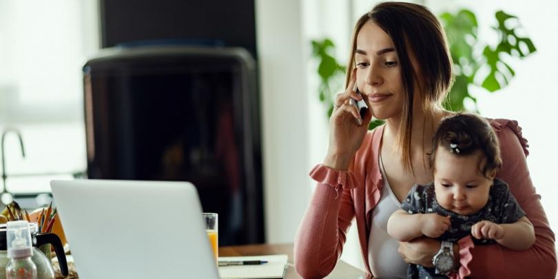 young mother working with child