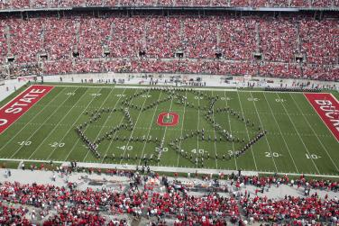Ohio State Marching Band at Ohio Stadium Making Recycle Emblem