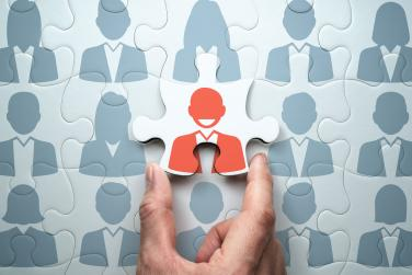 Graphic showing illustration of one person being selected from group of others