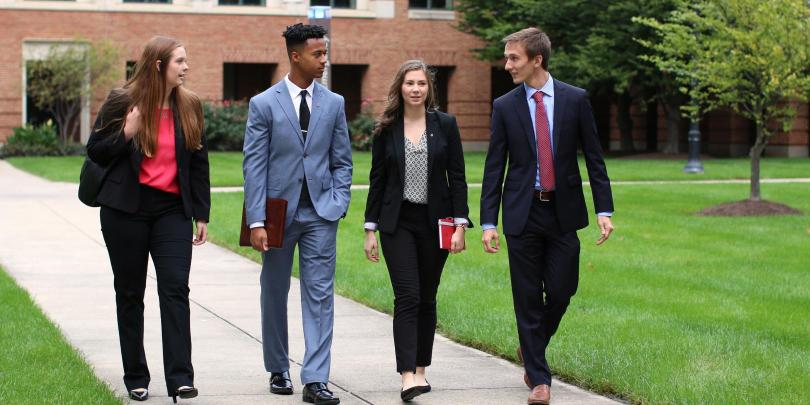 Students walking through Fisher campus