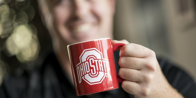 Man holding Ohio State mug