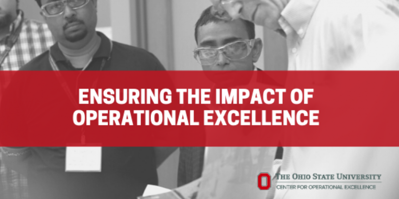 Three men in goggles working on something collaboratively (black and white image) with red box overlay with white text that reads: Ensuring the Impact of Operational Excellence