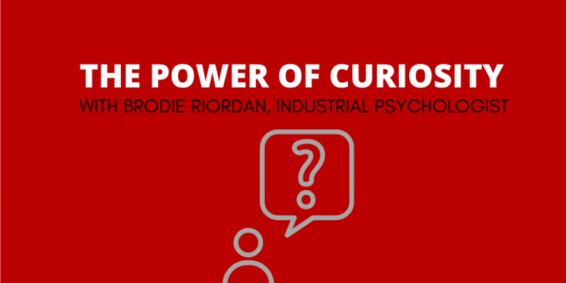 """Red background with white text that reads 'The Power of Curiosity With Brodie Riordan, Industrial Psychologist"""" -- icon of a person with a thought bubble and question mark above their head"""