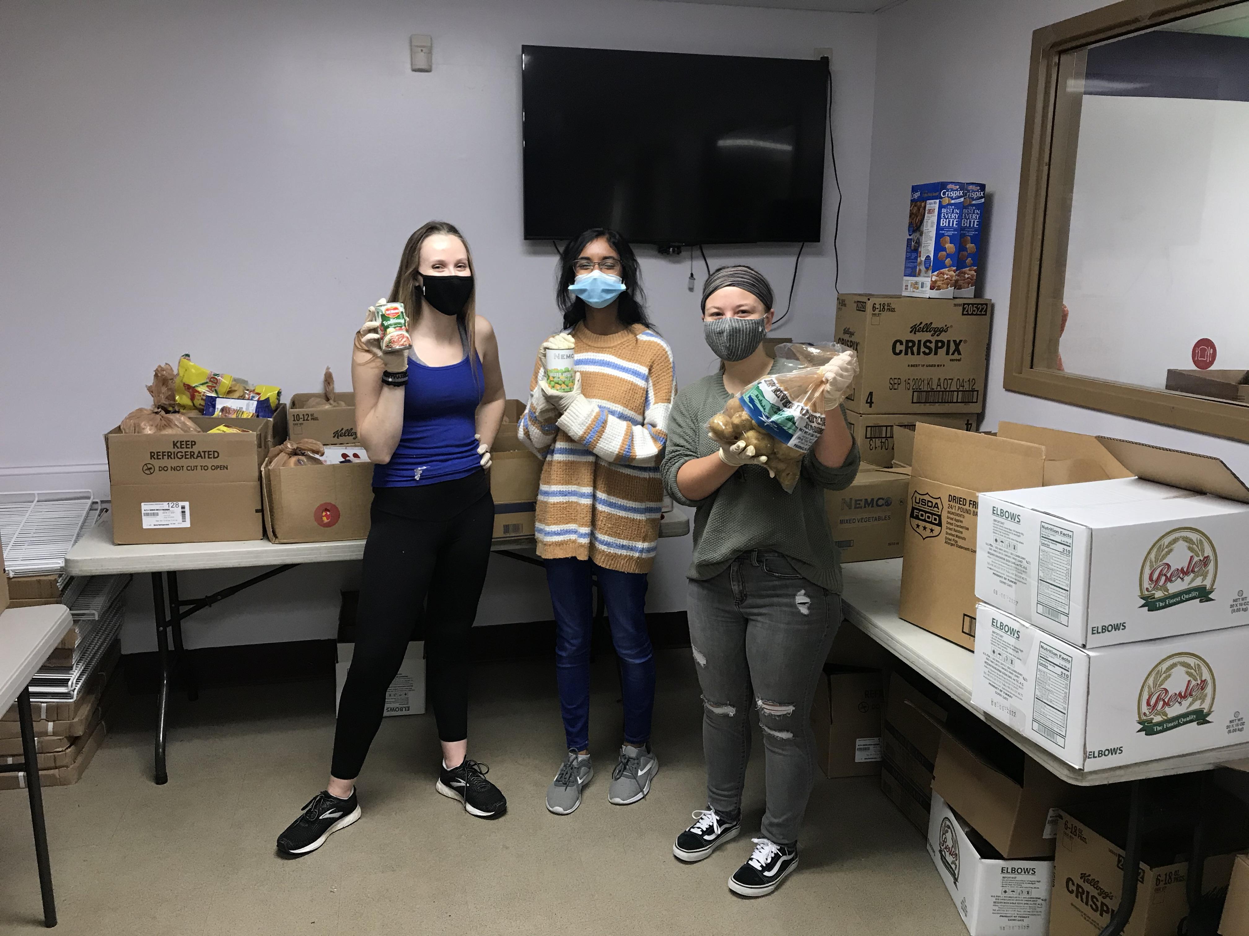 Students volunteering at a food pantry
