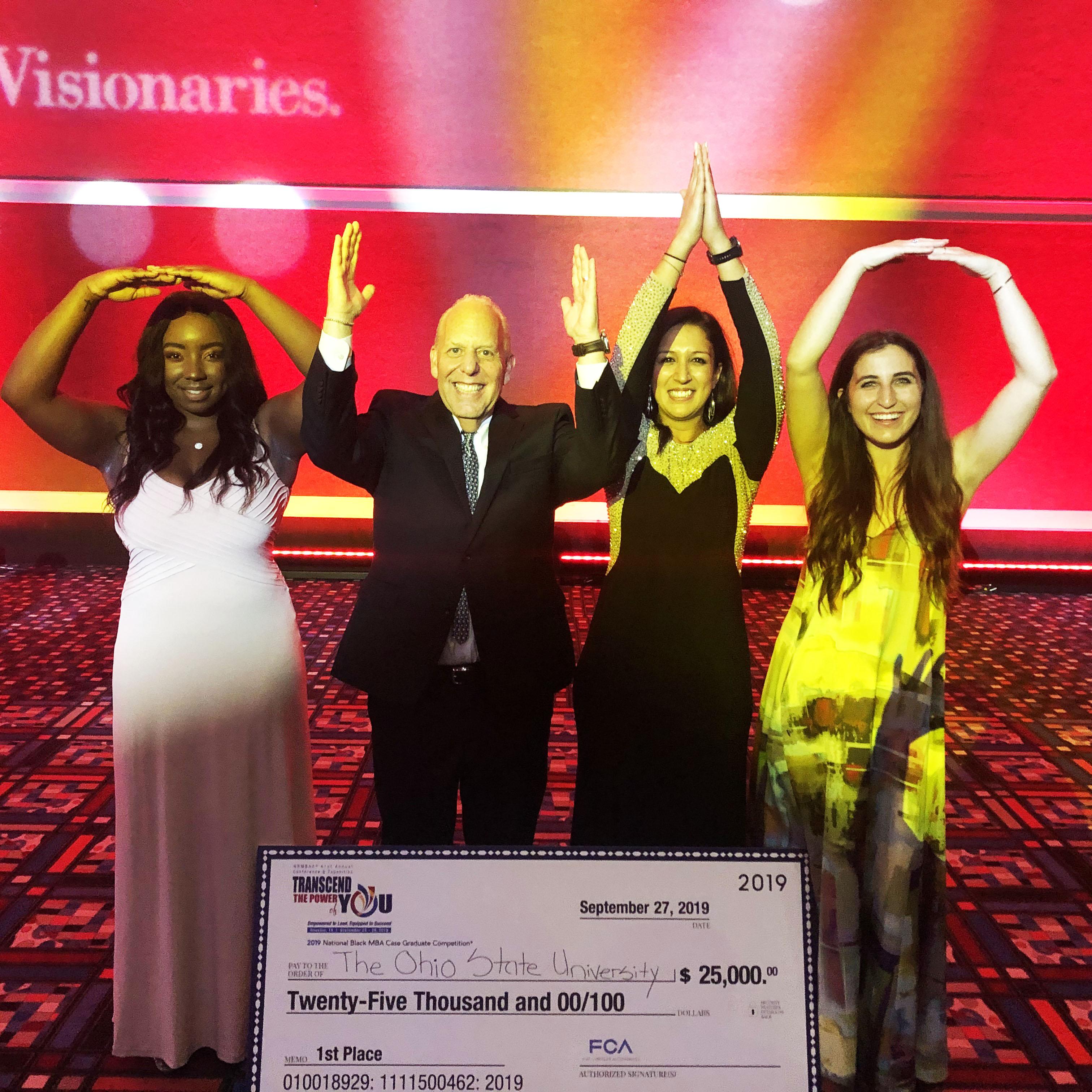 The winning MBA team shows their Buckeye spirit with O-H-I-O