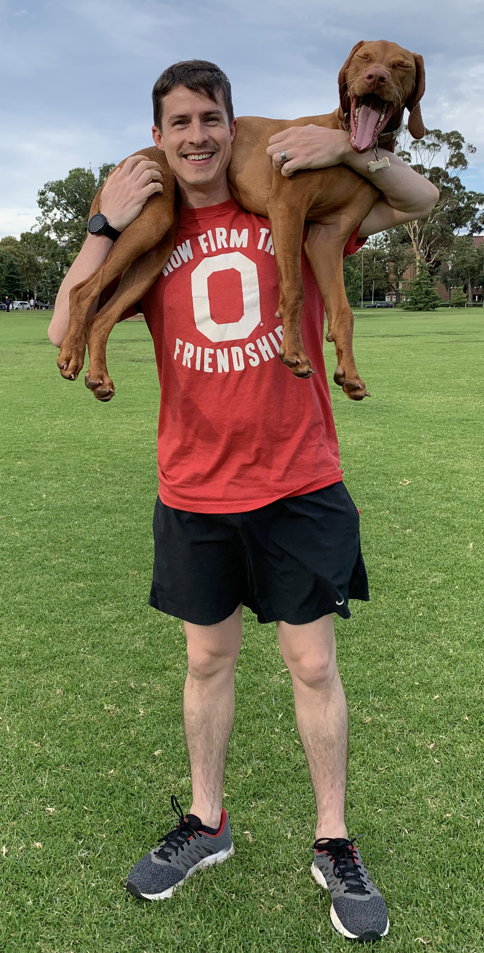 Josh Meyer in Ohio State t-shirt with his dog, Kaizen