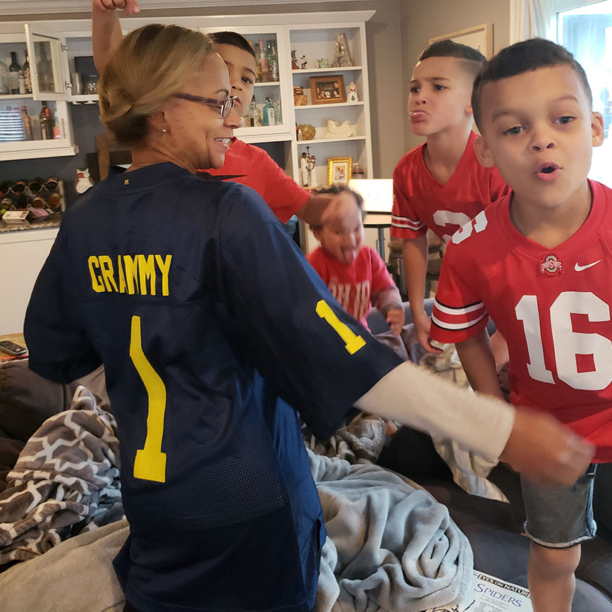 """Elicia Azali's children """"boo"""" and jeer their Grammy who is wearing a University of Michigan football jersey"""
