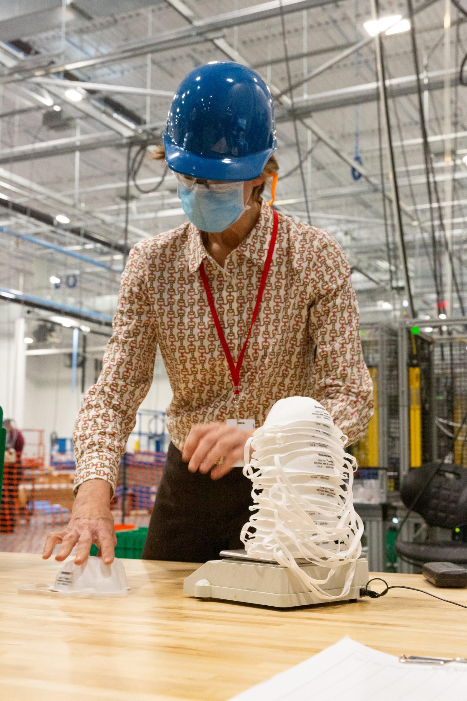 Honeywell employee making N95 masks