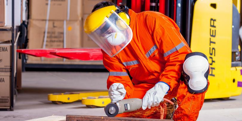 Stock image of a worker in safety gear