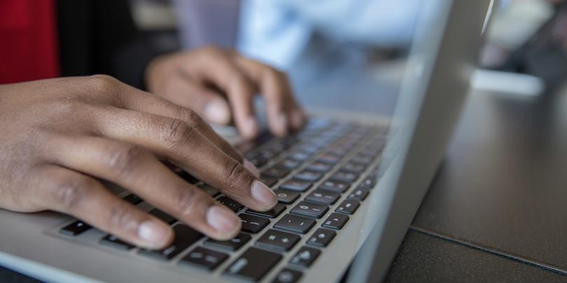 Stock image of a student working on a laptop