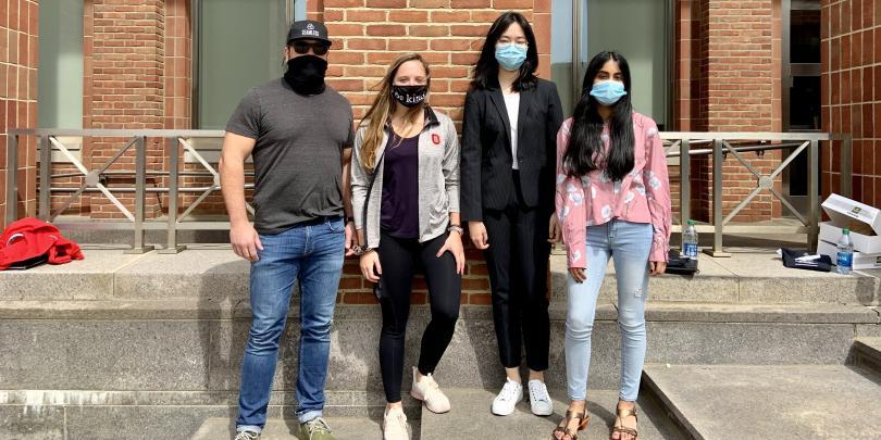 A team wearing masks outside