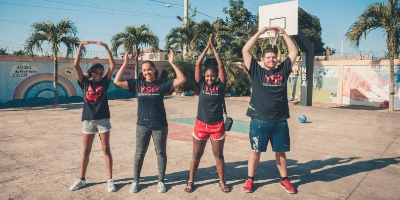 Students abroad posing O-H-I-O