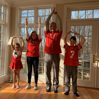 Dawn Lyons, husband, daughter and son posing O-H-I-O