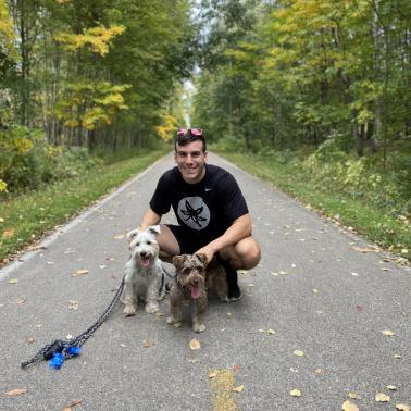Cole Williams on a path with two dogs